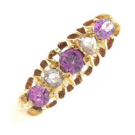 An early 20th century 18ct gold garnet and diamond five-stone ring.