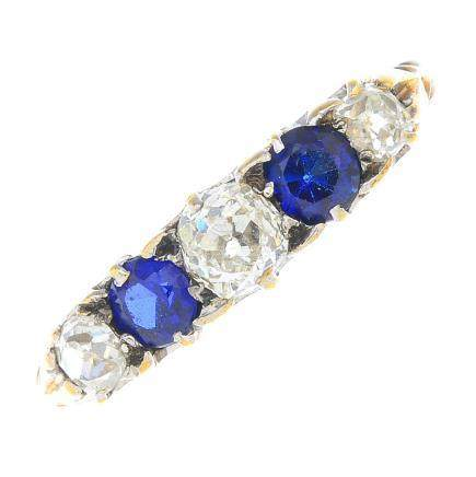 A diamond and sapphire five-stone ring.