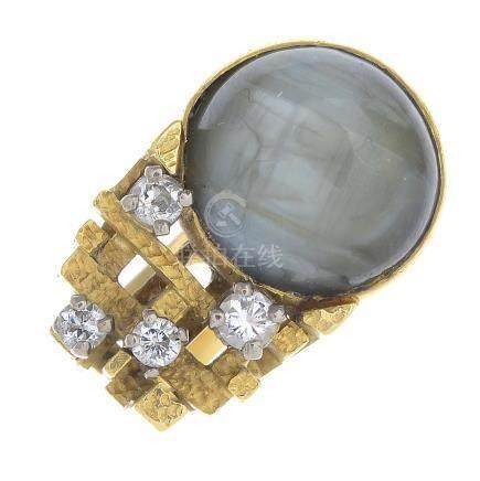 A chrysoberyl and diamond dress ring.