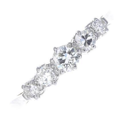 A diamond five-stone ring.