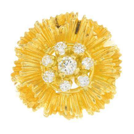 An 18ct gold diamond dress ring.