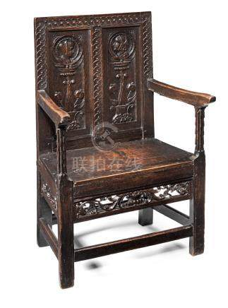 An exceedingly rare Henry VII joined oak double panel-back armchair, circa 1530