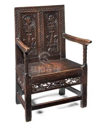 An exceedingly rare Henry VII joined oak double panel-back armchair, circa 1530