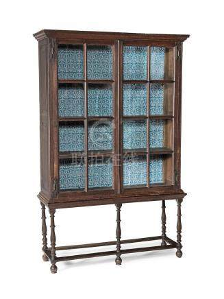 A rare William & Mary joined oak and glazed bookcase or display case on stand, circa 1690