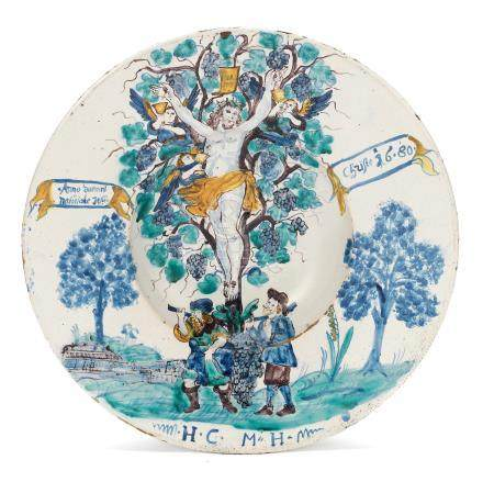 A Central European faience charger, dated 1680