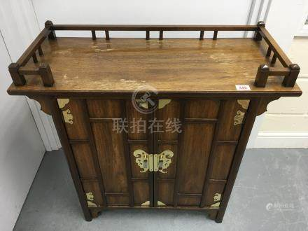 A modern Chinese style wooden cabinet with brass mounts.Approx 35.5x84x76.5cm high.NO RESERVE