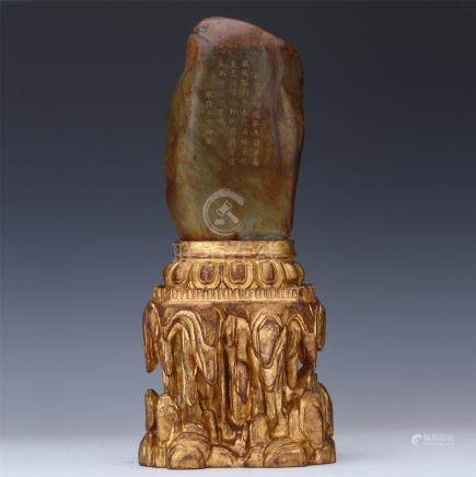 CHINESE BROWN JADE SCHOLAR'S ROCK ON LACQUER WOOD BASE