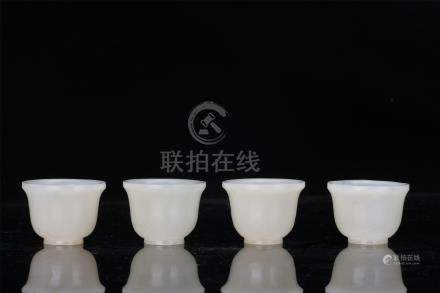 FOUR CHINESE WHITE JADE WINE CUPS
