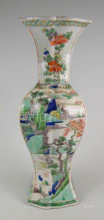 A good Chinese porcelain Famille Verte restored vase depicting figures & trees within landscape with