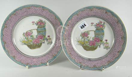 A pair of Chinese eggshell plates with pink & bird's egg blue ground borders, 21.5cms diam Condition