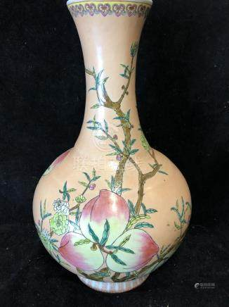 A Chinese porcelain bottle vase, painted with peach fruit and flowers on a peach ground, red printed