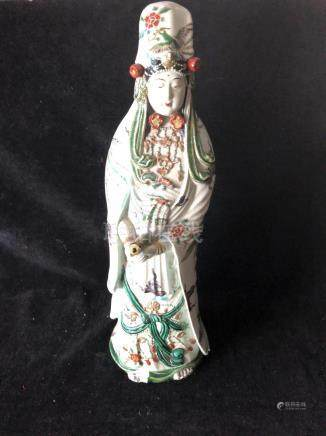 A large Japanese Satsuma pottery figure of Guan Yin, depicting the standing figure with ornate