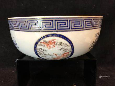 A Chinese export style bowl, probably European, painted with reserves of birds interspersed with