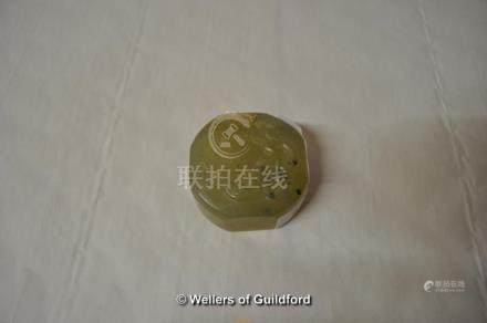 A Chinese jade seal carved with a dragon to the top, chamfered square form, 5cm diameter.