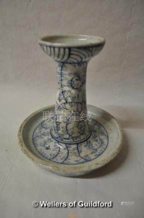 A Chinese blue and white candlestick with integral drip tray, 15cm high.
