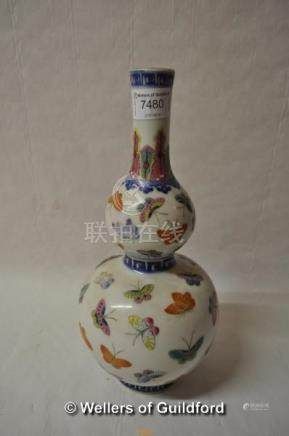 A Chinese polychrome double gourd vase decorated with butterflies, 29cm..