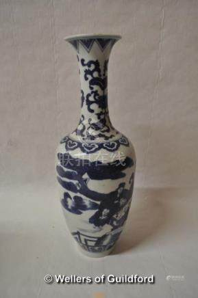 A Chinese blue and white vase with slender neck, decorated with figures in a garden, 31cm.