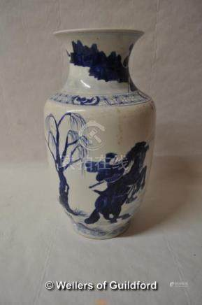 A Chinese blue and white baluster vase decorated with warriors on horseback, 29.5cm.
