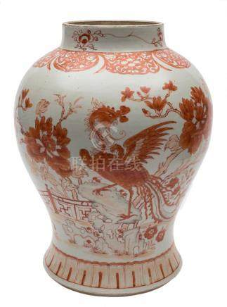 A Chinese porcelain baluster jar: decorated in iron red with a phoenix and tree peonies in a fenced