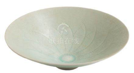 A Chinese Qingbai porcelain bowl: of flared conical form, covered in a crackled pale blue glaze,