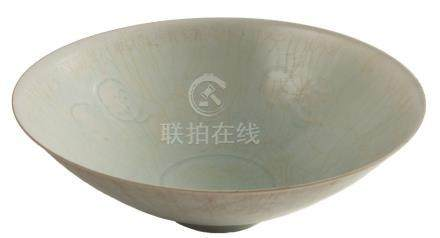 A Chinese Qingbai porcelain bowl: of flared conical form, covered in a pale blue crackled glaze,