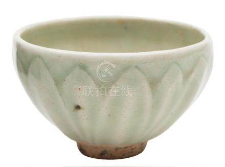 A small Chinese celadon bowl: the exterior moulded with lotus leaves, probably Song Dynasty,