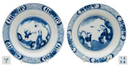 Two Chinese porcelain plates: each painted in blue with a mother and child beneath a willow tree