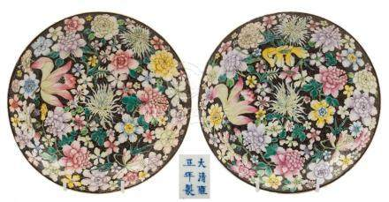 A pair of Chinese famille noire millefleur dishes: each painted with full blown flowers and foliage