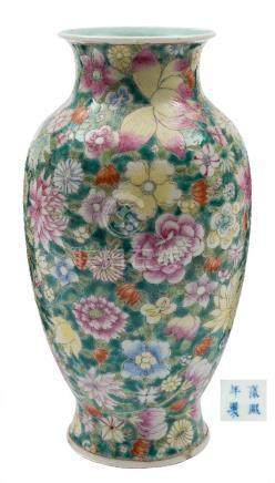 A Chinese famille rose millefleur vase: of baluster form with waisted neck and everted rim,