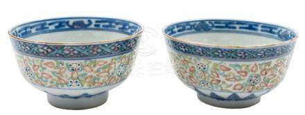 A pair of Chinese rice bowls: painted in underglaze blue, iron red,