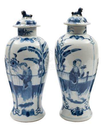 A pair of Chinese blue and white baluster vases and covers: with lion dog finials,