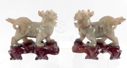 Pair of Chinese carved hardstone guardian lions