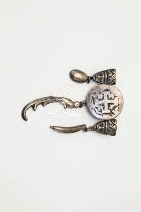 South American silver brooch