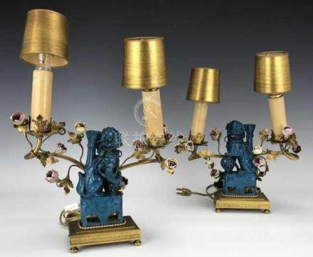 A PAIR OF CHINESE PORCELAIN FOODOG AND DORE BRONZE CAND