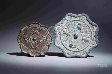 TWO BRONZE MIRRORS WITH FLORAL AND ANMINAL PATTERNS