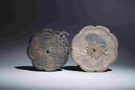 TWO BRONZE MIRRORS WITH FLORAL PATTERNS