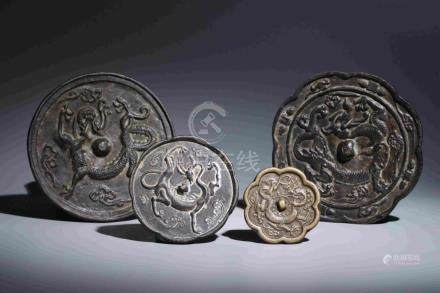 FOUR BRONZE MIRRORS WITH DRAGON PATTERN
