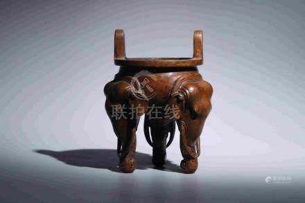 THREE-ELEPHANT LEGGED FURNACE