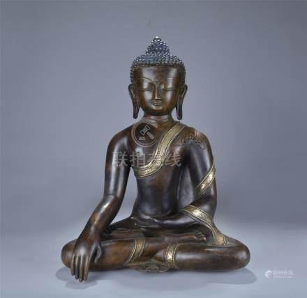 Qing dynasty partial gilt bronze figure of Sakyamuni