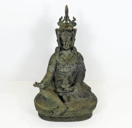 A Tibetan bronze Buddha with right hand holding va