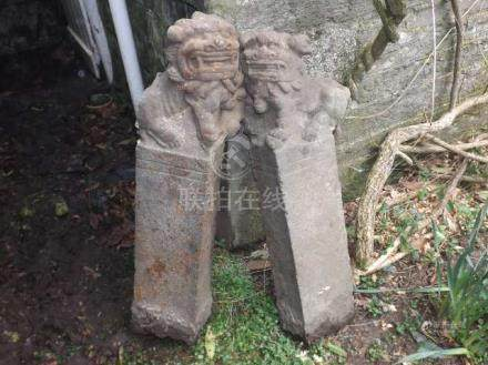 A pair of c.1500 Chinese carved stone temple foo d