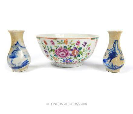 An Antique Chinese famille rose bowl and two miniature blue and white vases.