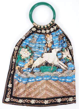 A 19thC Chinese embroidered bag, with Peking glass ring handles, the material section profusely