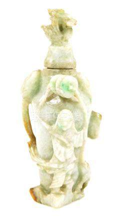 A Chinese polished green jade vase and cover, with shaped lid, carved stylized lotus flower body