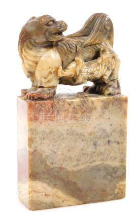 A 19thC Chinese soapstone desk ornament, formed as two dragons, on a rectangular platform base, 17cm