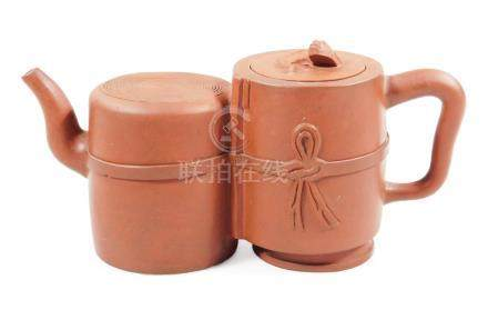 A Chinese red ware Yi Xing double teapot, of cylindrical form with a shaped handle, the lid with a