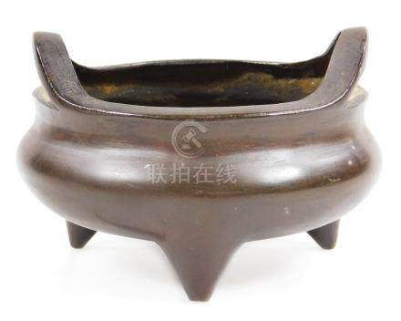 A Chinese cast bronze censer, bearing seal mark to the base, probably late Qing period, 11cm dia.,