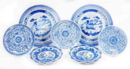Various Chinese blue and white saucers, two with pagoda landscapes, 22cm dia., three with foliate