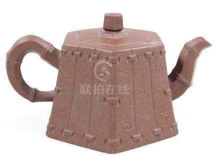 A Chinese redware Yi Xing teapot, of hexagonal tapered form, seal mark to base, 7cm H.