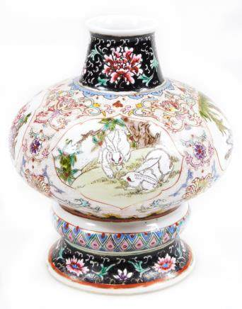 A Chinese porcelain vase, of compressed baluster form, hand painted with panels of cats, flowers and